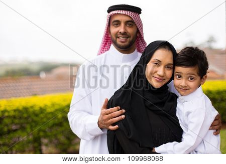 portrait of happy young muslim family outdoors