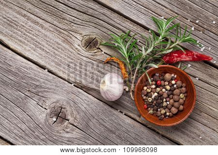 Herbs and spices on wooden table with copy space