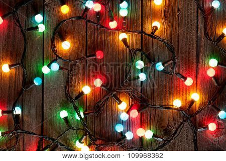 Christmas colorful lights on wooden table