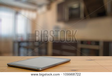 tablet on wooden table in the kitchen