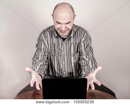 Angry and nervous businessman with a laptop