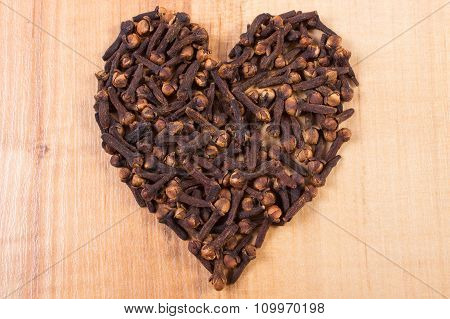 Heart Of Cloves On Wooden Table, Seasoning For Cooking