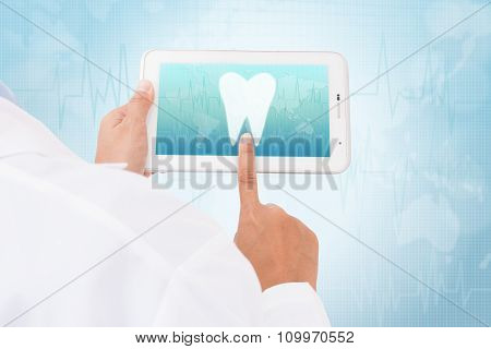 Doctor hand touch screen Tooth symbol on a tablet. medical icon