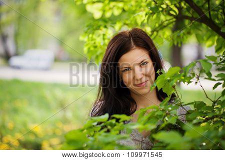 Portrait Beautiful Young Woman In A Garden.