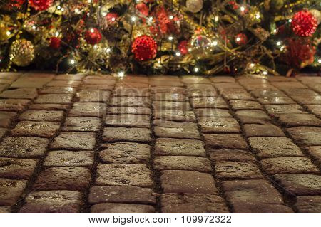 Cobblestone Pavement And Christmas Decorations On Background