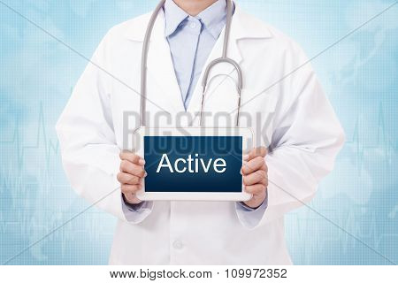 Doctor holding a tablet pc with active sign on blue background