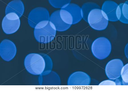 Abstract Background Of Blue Blurred Lights With Bokeh Effect