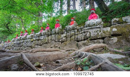 Wide angle of moss covered statues in Nikko