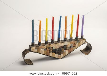 Hanukkah Menorah with candles on white background