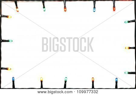 Christmas lights of different colors frame on white background