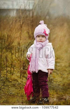 Little Girl  With Pink Umbrella In Autumn Park