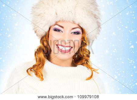 Attractive girl in a traditional winter dress over Christmas background with snowflakes.