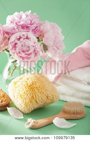 bath and spa with peony flowers brush sponge towels