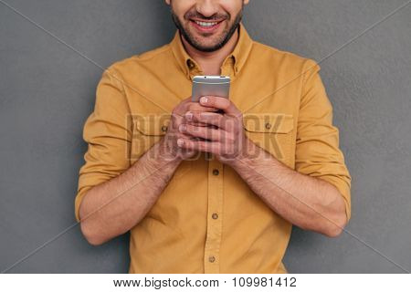 Examining His New Smart Phone.