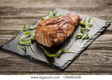 Delicious oven baked pork on a stone board