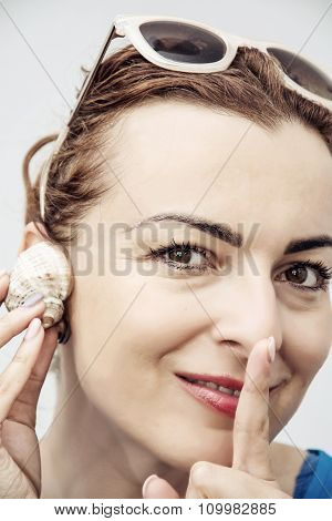 Young Caucasian Glamour Woman Listen Seashell And Finger To Her Mouth