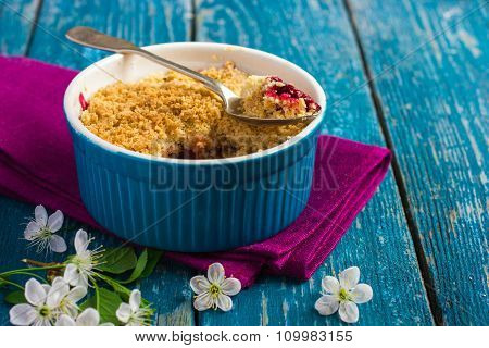 Plums Crumble Pie On Blue Ramekin