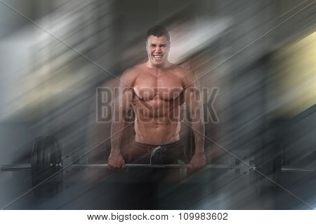 Trapezius Exercising With Barbell