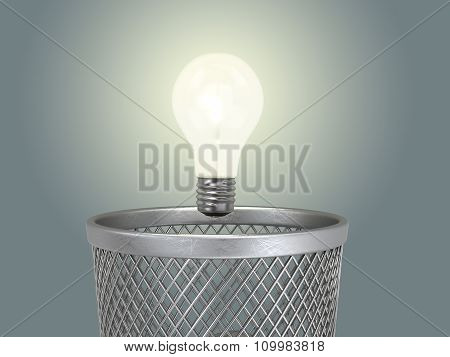 Eureka; Concept Of The Reborn Of Idea;  Glowing Light Bulb Under The Bin