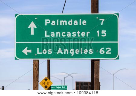 Los Angeles, Palmdale and Lancaster highway sign in California's Mojave desert.