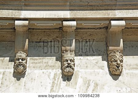 Masks, grotesque masks, the Pont Neuf in detail (Paris France)