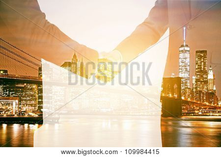 Double Explosure With Handshake Of Businessmen And Night City View
