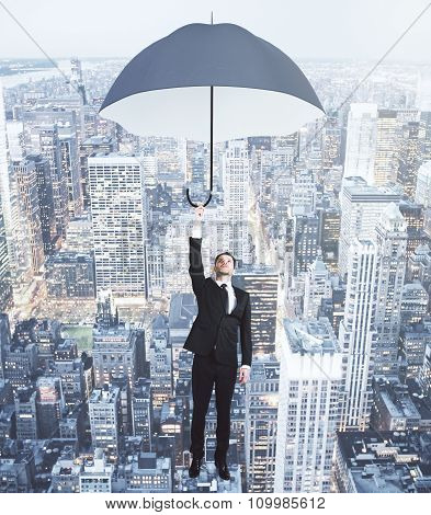 Businessman Flying With Umbrella Above Evening Megapolis City Concept