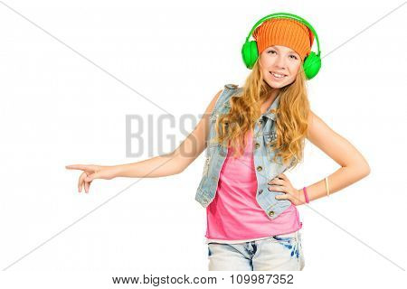 Pretty teenager girl enjoys the music in headphones. Studio shot. Isolated over white.