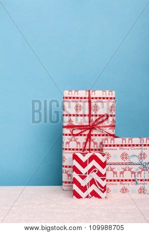 Decorative christmas gifts in snowy scene