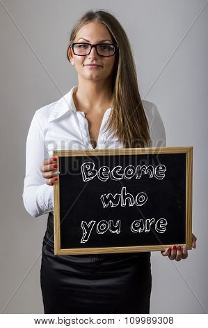 Become Who You Are - Young Businesswoman Holding Chalkboard With Text
