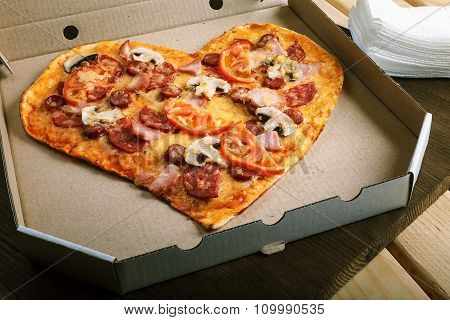 Pizza Heart Shape On Dark Wooden Background Top View