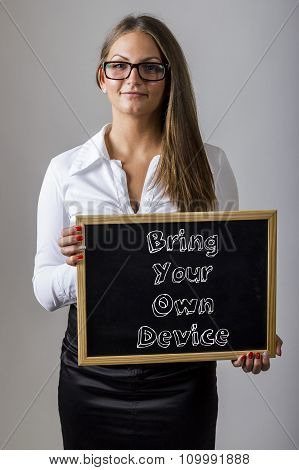 Bring Your Own Device Byod - Young Businesswoman Holding Chalkboard With Text