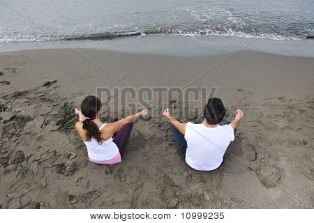 Couple Yoga Beach