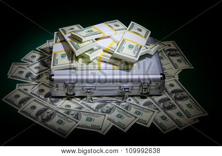 Dollars with metallic case on green table