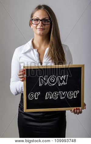 Now Or Never - Young Businesswoman Holding Chalkboard With Text