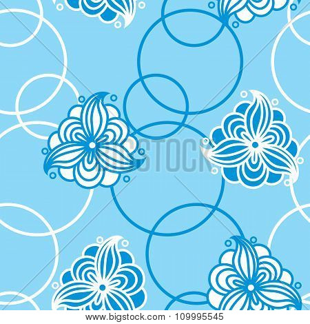 Seamless Pattern Of Abstract White Flowers And Circles On A Blue Background