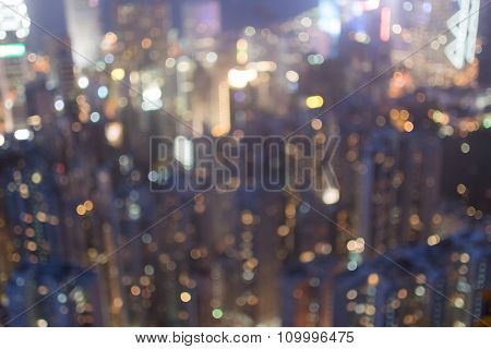 Abstract background of skyscrapers at night in Hong Kong, shallow depth of focus.