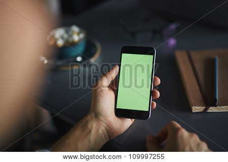 Human hand holding modern gadget