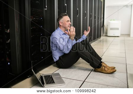 Technician feeling the pressure in server room at the data centre