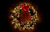 image of christmas wreath  - a christmas wreath with the lights turned on - JPG