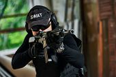 Постер, плакат: military industry Portrait of special forces or anti terrorist police soldier private contractor a