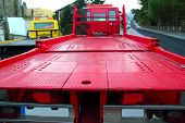 stock photo of truck-cabin  - Tow car truck red rear view perspective platform outdoor street - JPG
