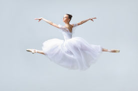 picture of ballet dancer  - cute young and beautiful ballet dancer jumping - JPG