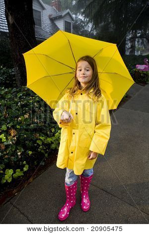 Young Caucasian Girl Playing In The Rain