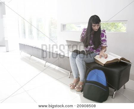 Attractive Asian Student Working With Laptop And Books
