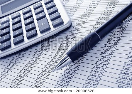 Pen And Calculator On Financial Spreadsheet