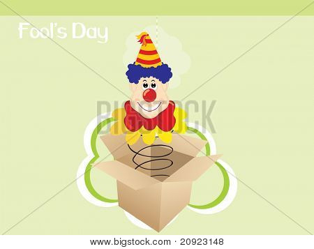 abstract green background with cardboard and jester face