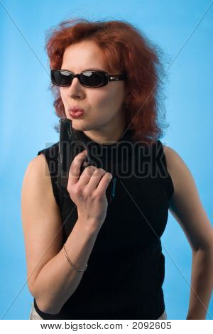 Red Haired Woman With Pistol