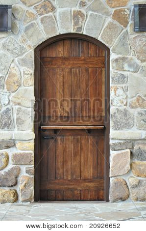 Wooden Door On Stone Wall