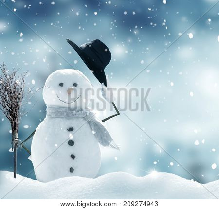 poster of New year greeting card with copy-space.Happy snowman standing in christmas landscape.Snow background